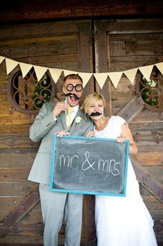 the best guest book. a simple photo booth with props and a chalk board.