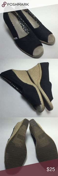 Toms wedge sandals CUTE PAIR OF TOMS CALYPSO OPEN TOE WEDGE WOMEN SIZE 9 1/2 BLACK CANVAS WITH JUTE WEDGE 3'' HEEL Has some creasing on the side of insole, Show some minor traced of used on the bottom sole and insoles but still more life left for using it.  SEE PICTURES FOR DETAILS Toms Shoes Wedges