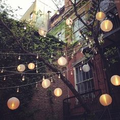 Strung lanterns in the city. for my townhouse vision