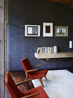 ooh navy blue walls with rich tan leather chairs …  NOT TO MENTION THAT FREE FLOATING SHELF…..