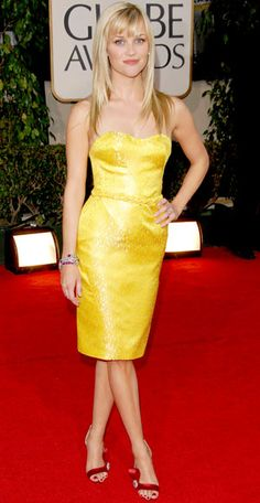 Reese Witherspoon made red-carpet history in Olivier Theysken's debut design for Nina Ricci. The yellow shantung bustier minidress was worn with red Brian Atwood shoes.