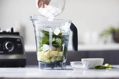 going green smoothie ingredients in a blender container