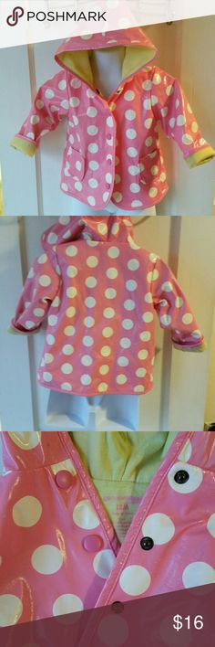 OshKosh Polka Dot Raincoat Gently pre-loved pink and white polka-dot raincoat with yellow lining and snap closures. Perfect except for minor pilling on lining. Osh Kosh Jackets & Coats Raincoats