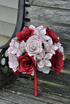 Made from recycled books and colored cardstock, these bridal bouquets are just the thing for your big day! They are totally customizable. If you want colors added, I have tons! If you want sheet music, book pages, or anything else, thats totally fine. I can do whole wedding parties.  HOW TO