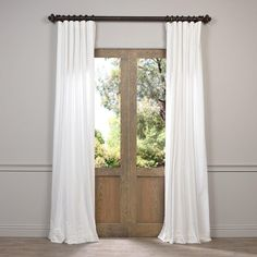 Give your windows an elegant look with these soft, cotton velvet drapes. These beautiful curtains will keep the light out and provide great insulation, making them perfect for any home.