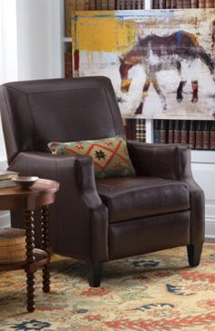 Since we love to nap and put our feet up while watching sports. Not overstuffed and small profile. Raquel Leather Recliner.