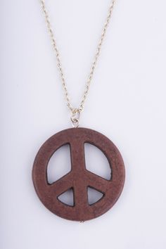 A personal favorite from my Etsy shop https://www.etsy.com/se-en/listing/483128754/brown-peace-sign-necklace-in-stone-peace