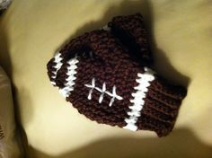 Mittens crochet... Football for my youngest nephew for Christmas!
