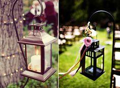 Hang lanterns on shepherds hooks along your wedding aisle.