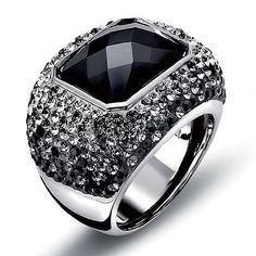 """Stunning Ring made of rhodium plated metal. The Star of the Ring is a sparking faceted Jet Black Rectangle Swarovski Crystal that measures approx. .5""""by .75"""" the main stone is surrounded by multi toned dazzling Swarovski crystal transitioning ombre look from white to smoky gray to black."""