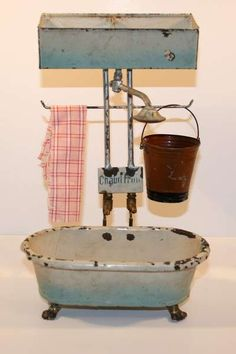America the apogee of plumbing.  Miniature Antique bathtub Chaud / Froid in metal with its mechanism. I experienced a more draconian loo in the UK - it felt even smaller than this,