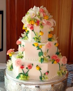 Just Desserts :: Outer Banks Wedding Cakes - Floral Cakes and Fresh Fruit Designs - something similar to this could be really beautiful - just san the decoration on top, a little less busy in general, and choosing flowers that match our theme