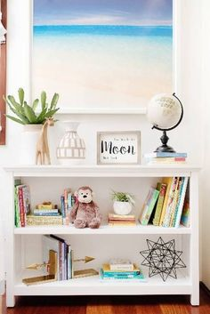 kids room design white bookshelf with beach print frame