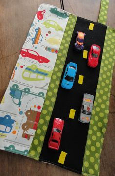 Car Caddy Roll up Tote with Road. Mine has 5 slots, velchro close