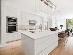 Looking for White Modern Kitchen ideas? Browse White Modern Kitchen images for decor, layout, furniture, and storage inspiration from HGTV. Pictures Of Kitchen Islands, Kitchen Pictures, Kitchen Island Table, Kitchen Island With Seating, Kitchen Cabinets, Kitchen Tops, Open Plan Kitchen, Beautiful Kitchens, Cool Kitchens