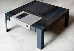 "Giant 3.5"" Floppy Disk Coffee Table . .oh my for the Nerd!! he would have to be single, don't think any woman would allow this in her house"