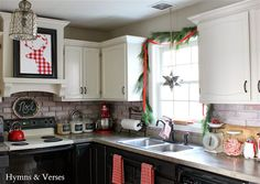 Christmas Kitchen - love the DIY Deer silhouette...and exhaust fan over stove treatment!