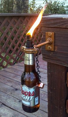 Make Unique Decorative Tiki Torches Out of Glass Wine/Beer/Soda/Olive Oil Bottles-Special Wick Holder. (Use clear bottles) obviously we would NOT use Coors Light beer bottles, because um yuck, but cool possible idea. Outdoor Projects, Home Projects, Craft Projects, Outdoor Ideas, Garden Projects, Backyard Ideas, Beer Bottle Crafts, Diy Bottle, Wine Bottle Tiki Torch
