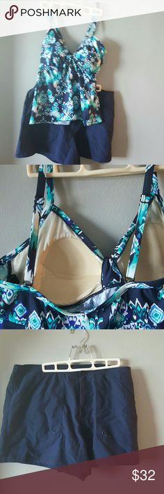 2 piece Swimsuit Navy Blue 16 Swim shorts and top! Swim shorts have liner.,zipper and button closer. Elastic waistline in back. Top is wonderful colors. Adjustable straps, padding for support. Really nice set. Like New Condition. Both are size 16 Swim