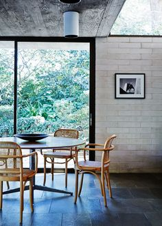 How nice these 811 bentwood armchairs look with the Florence Knoll table in this spare setting; we can specify this brace style for you.