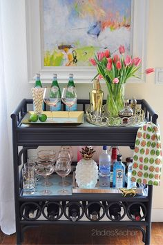 Ideas for Decorating Your Home with Flowers — 2 Ladies & A Chair - Pink tulips with this beautiful blush glassware from HomeGoods has the bar cart ready for a spring party! Sponsored by HomeGoods Diy Home Bar, Home Bar Decor, Bandeja Bar, Decorating Your Home, Interior Decorating, Decorating Games, Interior Design, Gold Bar Cart, Bar Cart Styling