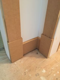 """Craftsman door jambs bottom plinth blocks made from 2 ply 1/2"""" MDF for total 1"""" thickness. Base is two piece made from 1/2"""" MDF flat sawn to 5-1/2"""" base with standard """"stop"""" molding for cap"""