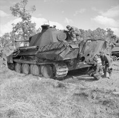 BRITISH ARMY NORMANDY 1944 (B 6046)   A 6-pdr anti-tank gun crew of the Durham Light Infantry, 49th (West Riding) Division inspect a knocked-out German Panther tank during Operation 'Epsom', 27 June 1944.