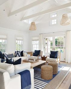 White and blue cottage living room features white slipcovered sofas adorned with. , < White and blue cottage living room features white slipcovered sofas adorned with blue pillows and blue fringe throw blankets facing a blond wood wat. Cottage Living Rooms, Coastal Living Rooms, Home Living Room, Living Room Designs, Coastal Cottage, Beach Living Room, Coastal Farmhouse, White Farmhouse, Cozy Living