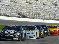 The new Generation 6 NASCAR Sprint Cup cars sit on the grid during testing at Daytona International Speedway.