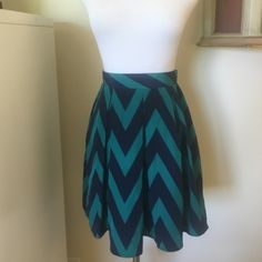 Francesca's boutique chevron skirt Chevron navy blue and green patterned skirt. By brand buttons purchased at Francesca's boutique. Never worn, in great condition. Francesca's Collections Skirts Circle & Skater