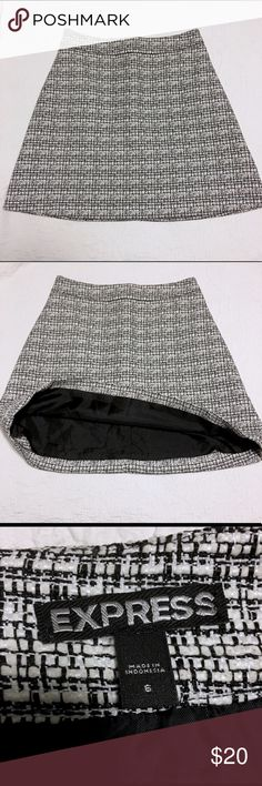 NWOT Express Black & White Winter Skirt NWOT. This is a great skirt for day to night. Would look great with a pair of black boots or heels.  Brand new, never been worn. Size 6. Unfortunately the security tag is still attached (see picture). Excellent condition otherwise. Express Skirts A-Line or Full