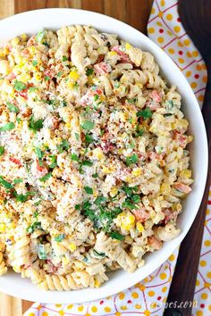 All the flavors of Mexican street corn, including fresh grilled corn on the cob, come together in this colorful and delicious pasta salad. Corn Pasta Salad Recipe, Caprese Pasta Salad, Best Pasta Salad, Pasta Recipes, Cooking Recipes, Mexican Tuna Salad Recipe, Summer Pasta Salad, Corn Recipe, Cooking Ideas