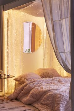 Romantic cozy bedroom with copper firefly string lights from Urban Outfitters