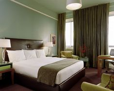 Light green colored walls, brown or brownish colored curtains are bringing mood of safeness and comfort in your bedroom.