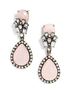 The natural beauty of pink opals shines among fine crystal work and antiqued gold fittings in these statement earrings.