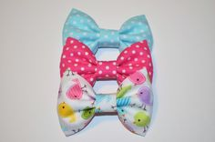 """Set of 3 bows measuring approx. 2""""x3"""" attached to a single prong alligator clip.*please note pattern layout may differ"""