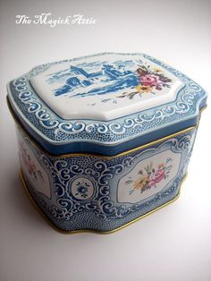 Beautiful vintage tin! Lovely light blue/white colored tin can with a lovely picture of an old church, gold tones and a floral pattern.    Perfect