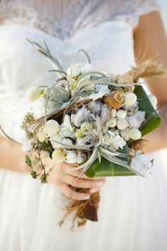 rustic and wild beachy bouquetft sea island cotton and air plants