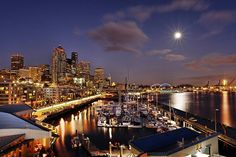 moon rising over Seattle waterfront