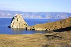 Traveling Olkhon Island on Lake Baikal. This was a very popular spot on Olkhon Island on the edge of the village of Khuzhir. It is also one of the most heavily photographed areas on Lake Baikal. Lake Baikal Russia, Planets, Traveling, Tours, Island, Popular, Day, Beach, Water
