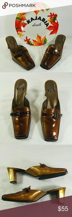 """💥NEW LISTING💥STUART WEITZMAN shoes. Size 7B Excellent condition Stuart Weitzman heel clogs Size.. 7B Pre owned. No rips. No spots Color.. brown/gold Made in Spain Almost 3"""" heel hight With no scratches at all Decarorative buckle on toe  Very nice looking !!  Perfect for any occasion!!  🚫NO TRADES 🚫NO MODELING 🔵REASONABLE OFFERS WELCOME !! Stuart Weitzman Shoes Heels"""