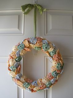 a spring wreath made with yo yos.