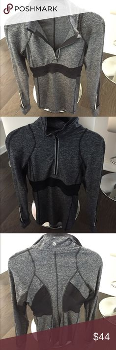 Lululemon zip up pullover size 4 Lululemon gray and black zip up pullover with zipper pocket in the back, thumb holes and hand covers. It's very fitted. Authentic from Nashville store. lululemon athletica Tops