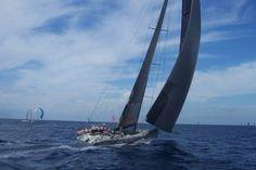 a-vessel-sailing-into-the-ocean-in-a-regatta-1382609