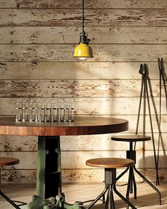Amanda this is what Im talking about doing with the wall. love the textures of shiplapped walls, tabletop, light fixture.