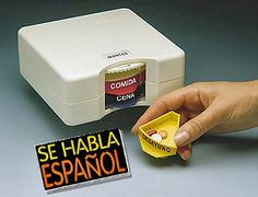 Pill organizer with Spanish text, each pill compartment is labeled with desayuno, comida, & cena. At the top of the device the day of the week is labeled (lunes, martes, miercoles, jueves. viernes, sabado, domingo). This pill organizer is non-electronic and easy to use. Purchase this device for $45.95. http://www.epill.com/dosifarma.html