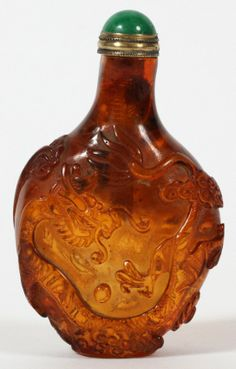 CHINESE CARVED AMBER SNUFF BOTTLE, H 3""