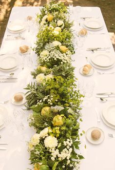 Lemon, lemon leaf, jasmine, dahlia, and chamomile centerpiece for a destination wedding