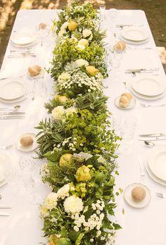 Lemon, lemon leaf, jasmine, dahlia, and chamomile centerpiece for a destination wedding