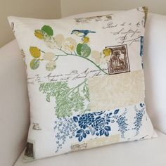 One decorative pillow cover. The front of the cover is done in shades of blue, green and a natural color on a white background. The back of the cover
